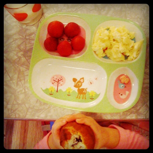 Saturday morning kid breakfast:  scrambled eggs, strawberries, fresh-out-of-the-oven blueberry muffins, dinosaur vitamin and cold milk.
