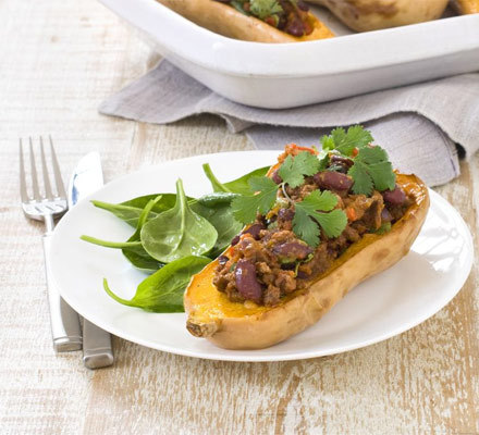 Butternut Squash with Chilli. 318 cals per serving. Click through for recipe. This is an amazing idea! I love stuffed vegetables and the combination of sweet squash with spicy chilli sounds to die for.