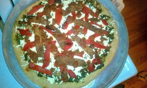 "reblogged from sunnshine:  This one has pesto, daiya, roasted red peppers, tempeh bacon, and marinara sauce  How many times can I use the ""pesto is the best-o"" line before it gets old? CUZ IT'S TRUE!"