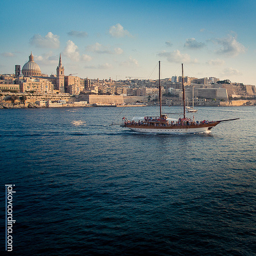Cruising in the Harbour (by ill-tempered [Jakov Cordina])  A boat cruising in the Harbour with Valletta in the background.  Taken during the World Wide Photo Walk Malta in Sliema  @illtempered