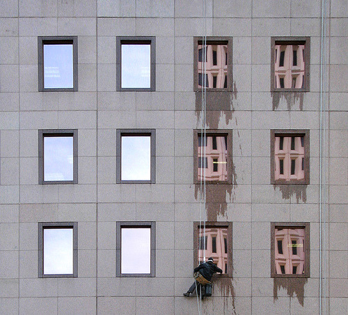 arreter:  Window Washer (by room929) The building reflected in the windows is the Residence College Hotel,previously seen in Building Pattern.