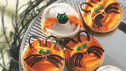 Bat and Cat Cookies INGREDIENTS: 1 roll (16.5 oz) Pillsbury® refrigerated sugar cookies 1 container (1 lb) vanilla creamy ready-to-spread frosting Orange gel food color Black string licorice 32 green miniature candy-coated semisweet chocolate baking bits 1 tube (0.68 oz) black decorating gel 24 miniature semisweet chocolate chips DIRECTIONS: Heat oven to 350°F. Make and cool cookies as directed. Remove 1/2 cup of frosting; tint remaining frosting with orange gel food color. Frost 8 cookies with white frosting. Frost 8 cookies with orange frosting. Place remaining orange frosting in food-storage plastic bag, and cut small hole in 1 corner. For bats, use white-frosted cookies. Place 1-inch spiral of string licorice in center of each cookie for body. Pipe wings on sides of body with orange frosting. For eyes, attach 2 green baking bits onto body of each with frosting; squeeze a dot of black decorating gel in middle of each eye. Place 2 miniature chocolate chips on each for ears. For cats, use orange-frosted cookies. Unroll and separate string licorice; place pieces of string licorice on cookies to look like ears and whiskers. Attach 2 green baking bits to each for eyes and 1 miniature chocolate chip for nose.