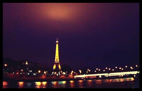 "#Paris indeed, an escapade awaits. Took this shot tonight. I can almost hear Madeleine #Peyroux's La Javaneise: ""La vie ne vaut d'etre vecue sans amour. Mais c'est vous qui l'avez voulu mon amour.""   Ah today, tonight was almost perfect… In fact, it was.  And may I add that my French is all coming back to me. I haven't had to say one word in English to locals tonight… from asking for directions, to purchasing tix to a tour on La Seine to ordering dinner and now a celebratory night cap. Bonsoir!"