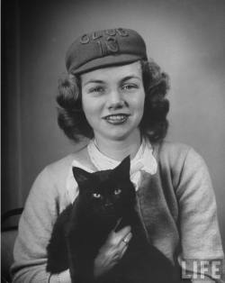 oldtimeycats:  Nina Leen, Helen Stone, member of the Sut Det Club, holding her cat, 1945. Source: LIFE Photo Archive, hosted by Google.