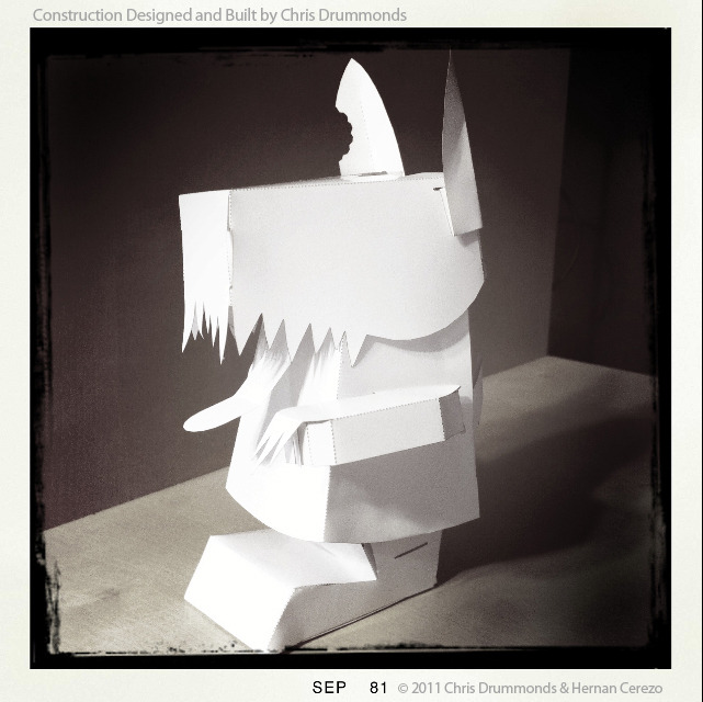 Chris Drummonds engineered and constructed the papertoy design for the zombie dog. :) He did a great job. We wanted this to be simple enough for anybody to be able to fold.