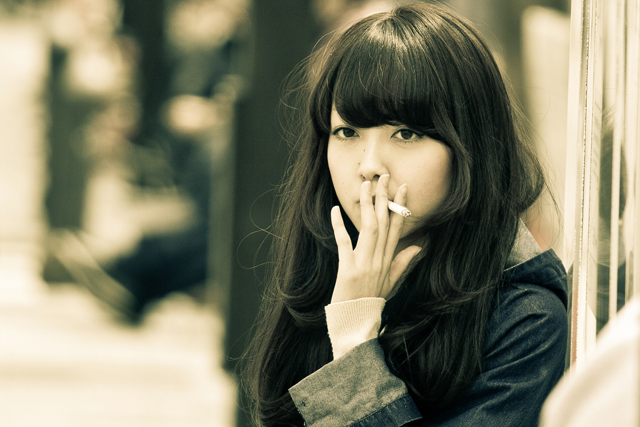 Daydreaming and Smoking in Harajuku on Flickr. Candid shot of a Japanese girl seemingly lost in thought, as she smokes a cigarette on the streets of Harajuku in Tokyo, Japan.
