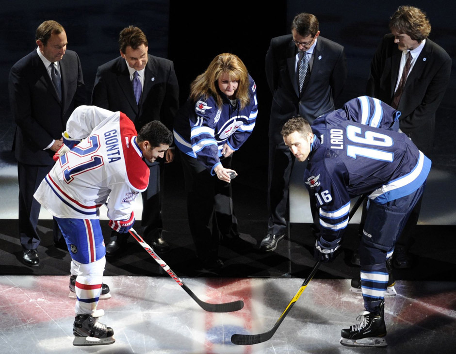 nationalpostsports:  GALLERY: Shelly Rypien, who is the mother of late NHL player Rick Rypien, drops the puck for the ceremonial face off at the Jets' home opener on Sunday. Todd Korol/Reuters