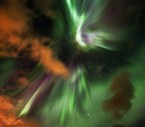 """Cloudy Night of the Northern Lights"" (via APOD: 2011 September 30)"