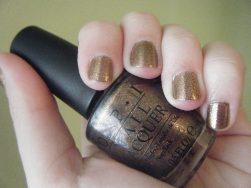 Nail of the Day: 10.10.2011 This warm copper shade, Warm & Fozzie, is from the OPI Holiday 2011 collection. I did a little research after purchasing three polishes from the collection at JCPenney on Friday, and it appears that the collection is not available at most retailers until November 1st. So if you have a JCPenney in your area, I'd start there. It's incredibly shimmery with gold and pink flecks in the copper base. This baby is definitely going to be a staple in my collection this autumn and winter. Warm & Fozzie: 2 coats