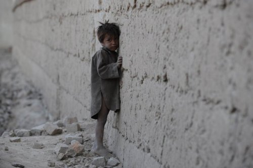 "AfghanistanAn Afghan boy leans against a wall as he cries on the outskirts of Kabul. Afghanistan is at the bottom of the Mothers' Index, compiled by the nonprofit group Save the Children, which shows that mothers and their children endure ""grim conditions,"" with one in six kids dying before the age of five, and one in three suffering from malnutrition. Shah Marai-AFP/Getty Images"