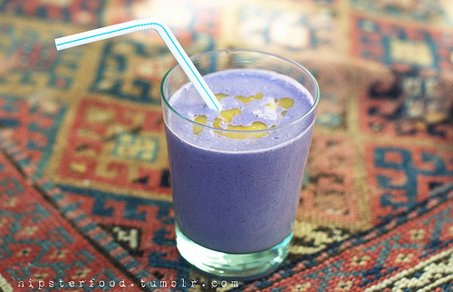 hipsterfood:  blueberry peach almond smoothie (more like shake!), because for some reason it's 77F here today. in your highest-powered blender, blend until consistent and smooth: 3/4 cup soaked raw almonds 2 cups ice water 1 cup frozen blueberries 2 tbsp sugar (we use sugar in the raw, aka sucanat) 1/8 cup liquid sweetener (we use agave, also try maple syrup or date syrup) rice milk as needed (to get the consistency you like) if you don't have a very reliable blender, you might want to blend the almonds separately. pour the smoothie out into cups and rinse out the blender. put in 2 cups thawed frozen peaches, and blend until it's a nice thin consistency. pour into each drink, swirling it around. this serves 2-4 people.