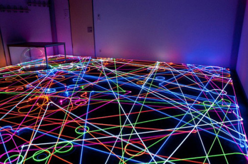 "Mapping Cleaniness : Roomba Vacuum Art ""For those of you who are love lasers, robots and household chores, here is the perfect activity for you. Artists from around the world have been attaching various lights on top of Roomba vacuums, the saucer-shaped vacuuming robots straight out of the Jetsons, and taking long-exposure photographs documenting their automated excursions across the floor. The results are wild, like scenes from Tron or a tripped out Dan Flavin-themed party. Click for more."" Reminds me of my Robotic Interface class I took at the Dessau Institute of Architecture."