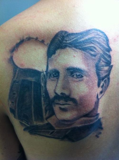 This portrait of Nikola Tesla was done by my friend Max Lowe at Cherry Bomb Tattoo in Martinsburg. His apprenticeship just ended recently so I let him do his first human portrait on my shoulder. It's not finished yet, electricity and finishing the tower are soon to come.