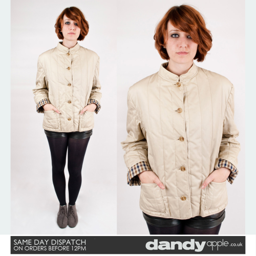 "Newly listed @ www.dandyapple.co.uk Link: http://bit.ly/mUfTir Womens Vintage Retro Original Aquascutum Beige Quilted Jacket. *   Beige in colour, with classic brown, white and blue check pattern lining. *   Fastens up down the chest with five round buttons. *   Two open hip pockets. Round, crew neck collar. *   Label reads; ""Aquascutum - Regent Street London - Made in England"". *   Sam is a size 8, 5 feet and 6 inches tall. Size: 10 Material: Cotton Condition: No visible faults, marks or stains. Great used vintage condition."