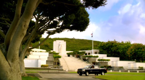 """LANAKILA"" 1x4  National Memorial Cemetery of the Pacific The National Memorial Cemetery of the Pacific (also known as Punchbowl National Cemetery) is a cemetery located in Honolulu for those men and women who served in the United States Armed Forces. Since the cemetery was dedicated on September 2, 1949 roughtly 34,000 veterans of World War I, World War II, the Korean, and Vietnam wars have been interred. The cemetery is now full and a new veterans cemetery (Hawaii State Veterans Cemetery) has been built and dedicated on the windward side of Oahu in Kane'ohe. McGarrett senior would not have been buried here. In the background we see Steve drive past the Honolulu Memorial, a statue of Lady Columbia intended to represent all grieving mothers. She stands on the bow of a ship holding a laurel branch. The inscription below the statue, taken from Abraham Lincoln's letter to Mrs. Bixby, reads ""The solemn pride that must be yours, to have laid so costly a sacrifice upon the altar of Freedom."" The statue of Lady Columbia is also featured in the opening credits of the show, and was featured in the opening credits of the original Hawaii Five-O series."