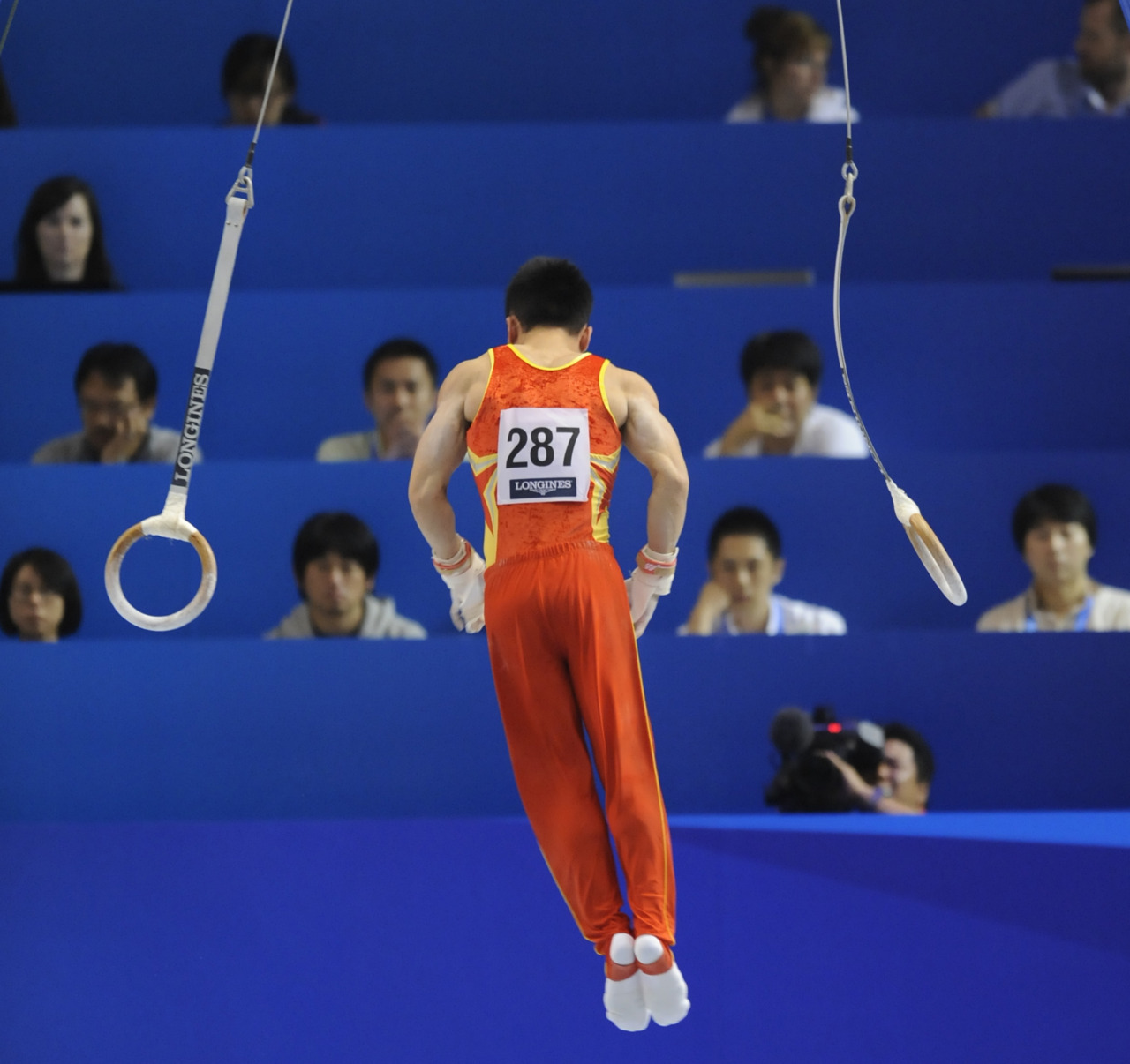 Guo Weiiyang of China performs on the rings during the men's team event of the qualification round at the World Gymnastics Championships in Tokyo on October 10, 2011. The eight top-scoring teams from the qualifying round will advance to the men's team finals on October 12.  Photo: Kazuhiro Nogi/AFP/Getty Images