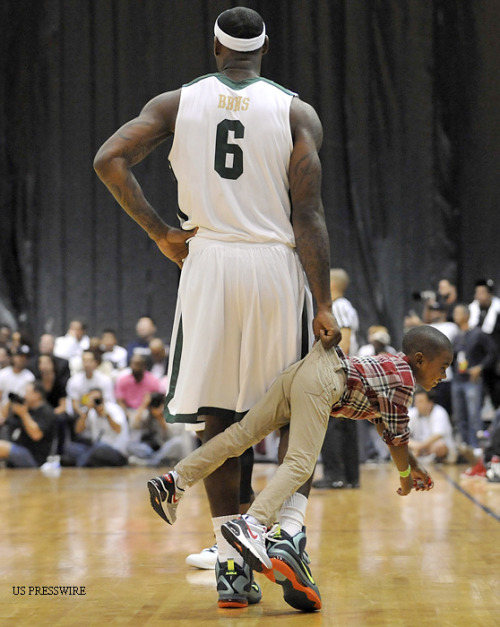 siphotos:  LeBron James makes a new friend during the South Florida All-Star Classic, an exhibition game featuring a slew of NBA stars at Florida International on Saturday. Team James, which included Chris Bosh, Rajon Rondo and Rudy Gay defeated Team Wade 141-140 after Wade sank two free throws with 3.2 seconds left. Wade's teammates included Chris Paul Amar'e Stoudemire and Carmelo Anthony among others. The NBA Lockout is now in its 102nd day. (US Presswire)