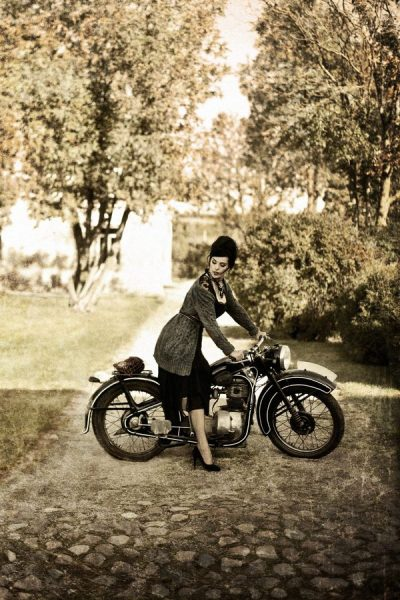 Beautiful portrait of a woman with a vintage motorcycle. So classy.