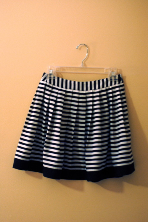 New Lengths I've added two new skirts to my closet, a mini and a midi. The black and white striped pleated mini will be very easy to dress up (a red sweater would look great!) and would also look adorable with a slouchy tee (unexpected, yet cute!). The pleated polka dot midi is a great alternative to pants in the fall, and you don't have to worry about crazy wind nearly as much. Strappy heels and a thin belt are great accessories to wear with this piece (it's a great way to add length and slim the figure, and lord knows I need to extra inches beneath my feet!) Striped Mini - Forever21 Polka Dot Midi - Forever21
