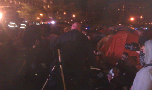 thenoobyorker:  cognitivedissonance:  The scene at #OccupyBoston. They are beating war veterans with Veterans for Peace. Boston Police breached the camp and are destroying tents, are threatening making mass arrests. Watch it here. The police line inside the camp:   Come on guys, who watches the watch men? I guess we all do now…
