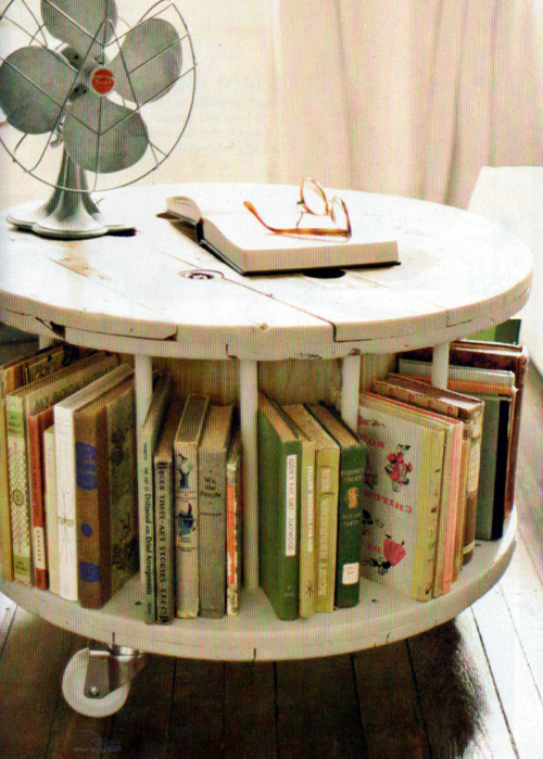 wooden cable spool turned bookshelf (via Country Living's September Issue)