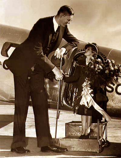 theloudestvoice:  Mary Pickford being greeted at the St. Louis Airport by Robert Wadlow, the world's tallest man, 1938