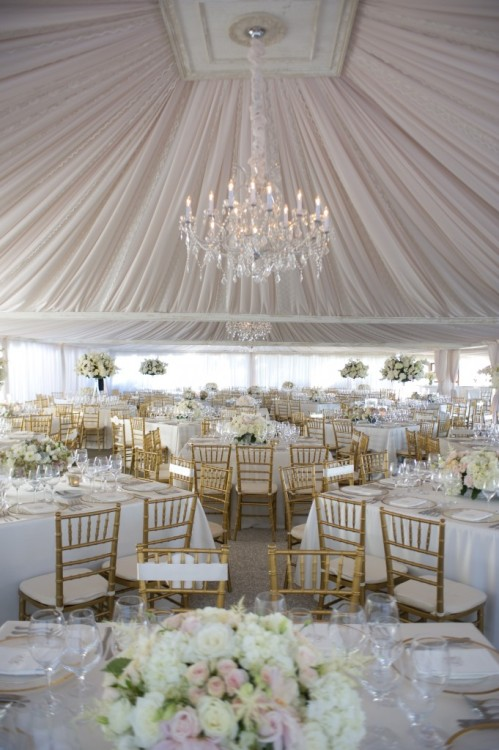 Dramatically draped tent for a wedding reception via Experiences by Kristin
