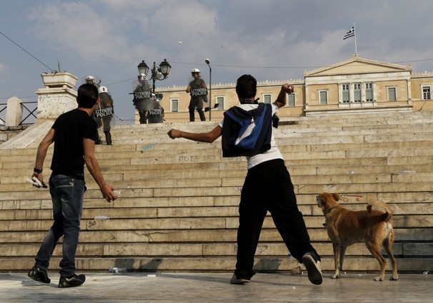 rebeldog:  5 oct 2011, #Syntagma: fighting the system next to two kids. The kids are alright. A great photo by Petros Giannakouris