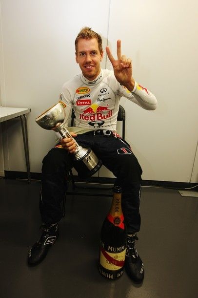SUZUKA, JAPAN - OCTOBER 09: Sebastian Vettel of Germany and Red Bull Racing celebrates in his changing room with the third place trophy which secured his second F1 World Drivers Championship during the Japanese Formula One Grand Prix at Suzuka Circuit on October 9, 2011 in Suzuka, Japan. (via Photo from Getty Images)