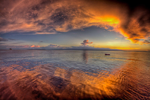 lori-rocks: Sunset on the way back to manokwari  By Paul Cowell