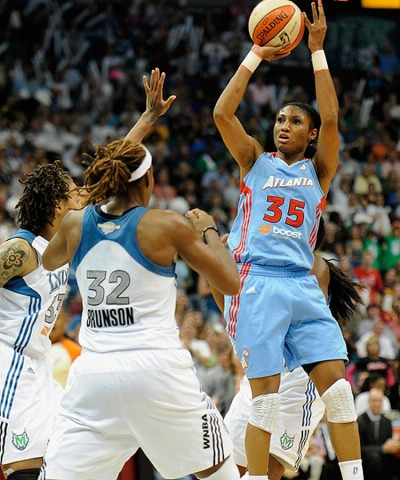 Angel McCoughtry of the Atlanta Dream setting an WNBA Finals record with 38 points in Game 2 against the Minnesota Lynx. Minnesota won the WNBA Championship in 3 games straight however.