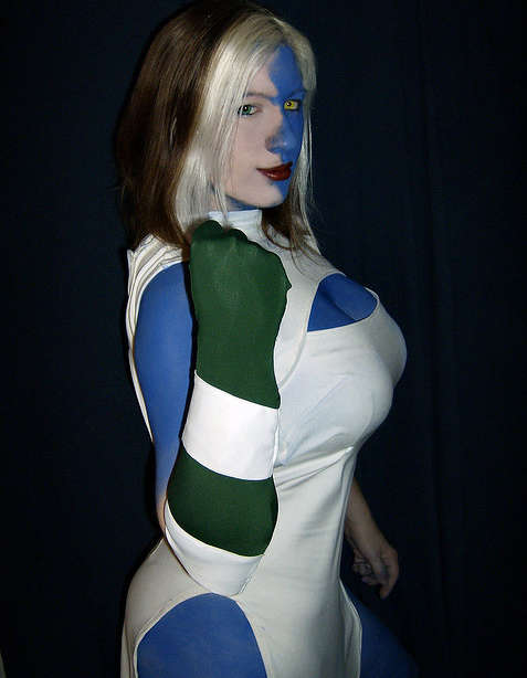 geeksintights:  Mystique by BelleChere For more comic book cosplay goodness, follow Geeks in Tights!  It's funny, this picture was such an after-thought. I just took off my Mystique wig (this pic is my real hair), was starting to remove the makeup, and was struck by the idea. That's why the skull belt is missing - I was halfway out of getting out of costume! I guess I'm a sucker for angst - I've always loved the relationship between Rogue and Mystique.