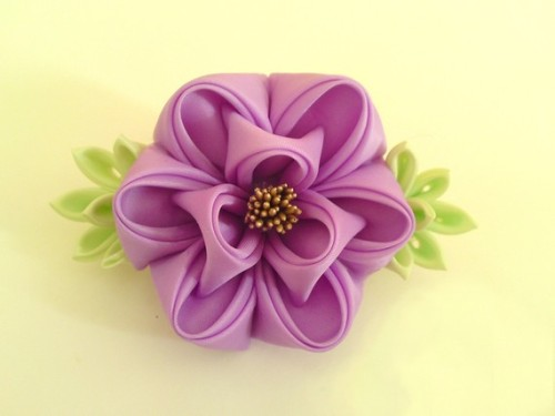 I remember learning about kanzashi in Japanese class. They're so pretty and so intricate.