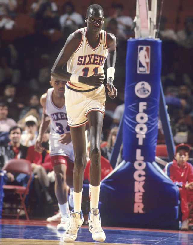 Manute Bol (7-foot-7, 200 lbs) runs back on defense during a 1990 game between the 76ers and Pacers. (Manny Millan/SI) GALLERY: Classic photos of Manute Bol