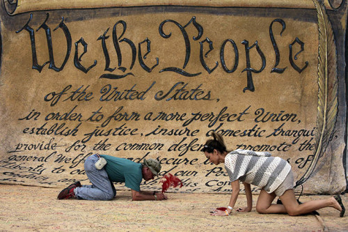 thepoliticalnotebook:  Picture of the Day. Washington, DC. Occupy DC protesters sign a huge copy of the Constitution in MacPherson Square. Photo Credit: Yuri Gripas/Reuters  Via. View more Picture of the Day posts. Submit a photo.
