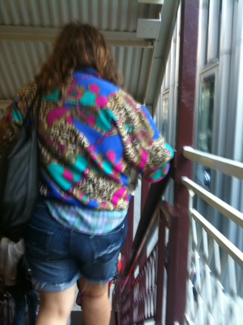 The 80s threw up on her windbreaker! The only things missing: neon plastic hoop earrings, crimped and teased side ponytail and [gasp] leggings as pants. Sick!