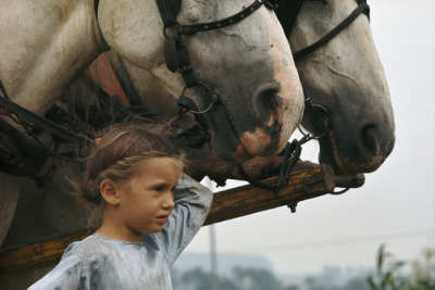 candyheilman:  A young Amish girl holds the reins of two huge draft horses. Lancaster County, Pennsylvania. William Albert Allard/National Geographic.