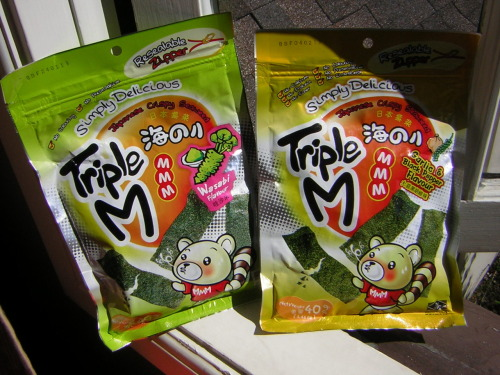 I have the best boyfriend.  He got me two 40g bags of fried seaweed snacks: one is wasabi flavored, and the other is garlic & black pepper flavored.  Though a bit oily, they are delicious and best of all: they have coons on the front! The company that makes them is called MMM Seaweedsnacks.