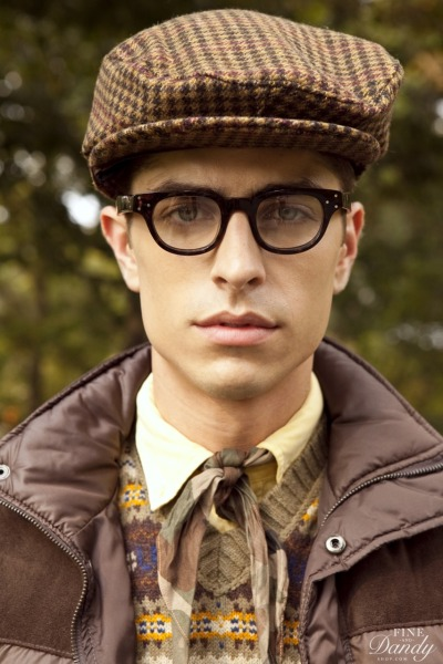 From the new FineAndDandyShop.com lookbook! Camouflage Neckerchief, Brown Ivy Cap w/ Ear Flaps; vest: Zara, shirt: J. Crew, sweater vest: vintage. Photo: Ken Pao.