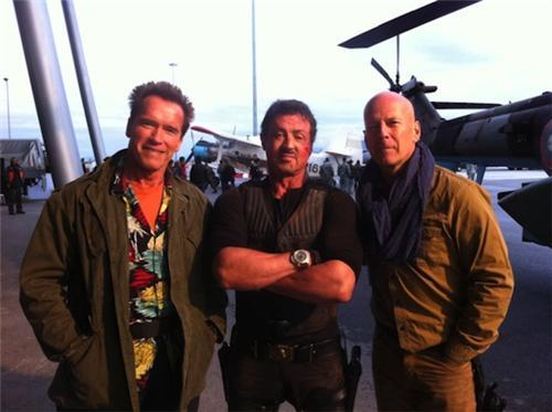 "thedailywhat:  Today On TDW: Gossip — Above: Schwarzenegger, Stallone, and Willis reunite on the set of Expendables sequel. Say What?: Samuel L. Jackson joins Twitter. Beyoncé rep says bogus baby bump rumors bogus. Tracy Morgan defends homophobic rant as ""art."" Michael Douglas, Matt Damon to play lovers in Steven Soderbergh's Liberace biopic. Taylor Swift becomes youngest singer/songwriter to win Billboard's Woman of the Year. Javier Bardem to play villain in next Bond film. Weaponized K-Pop: Rain joins the South Korean military. Celebrity chef Hugh Fearnley-Whittingstall says dog meat same as pork."