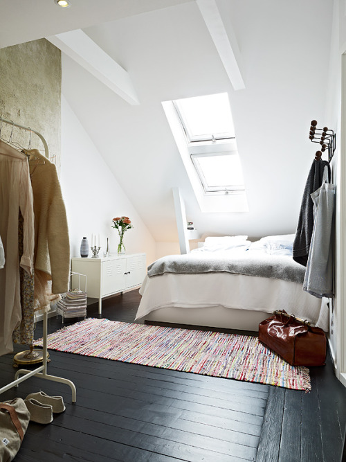 I'm crazy about this bedroom. The charcoal floor is remarkable.