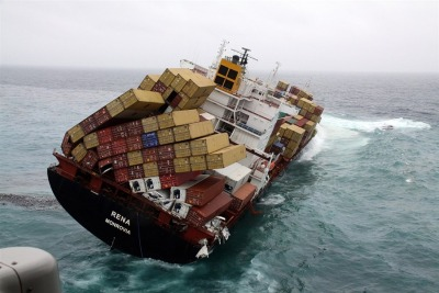 inothernews:  This is what it looks like when a container ship runs aground atop a coral reef and starts to list, dangerously, threatening not just to spill over its cargo — about 70 containers have gone overboard already — but also the fuel in its hold, some of which has already made its way to the shores of New Zealand.  A structural crack has appeared in the hull amidship, all the way to the deck, which doesn't help. (Photo of the doomed cargo ship Rena, grounded atop the Astrolabe Reef near Tauranga, New Zealand since Oct. 5, by the Maritime New Zealand Agency via the AP / MSNBC.com)