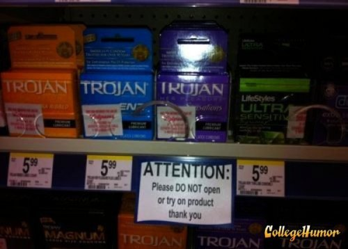 "Don't Try On Condoms Sign They better accept ""barely used"" as a reason for return."