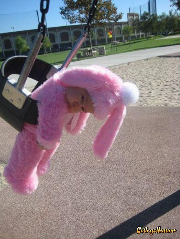 Sad Baby in Cozy Costume Stuck in Swing