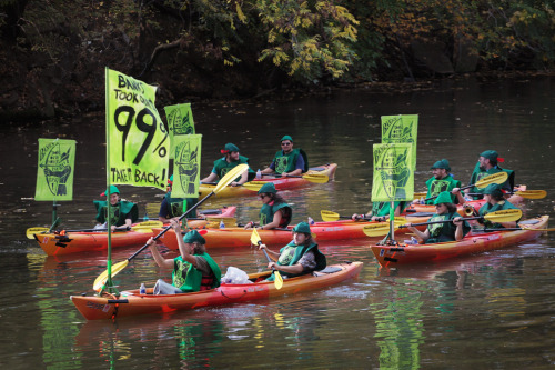 Photo of the day: Occupy Wall StreetDemonstrators dressed in green Robin Hood outfits paddle their kayaks down the Chicago River on Oct. 10 toward downtown to join a protest outside a conference for the American Mortgage Bankers Association in Chicago. Organized by Take Back Chicago, a coalition of community and labor groups, several thousand people participated in the protest, and 21 people were arrested over the course of the day for acts of civil disobedience.