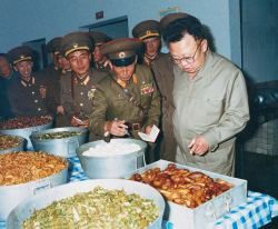 kimjongillookingatthings:  looking at sausages, also vaguely pointing.