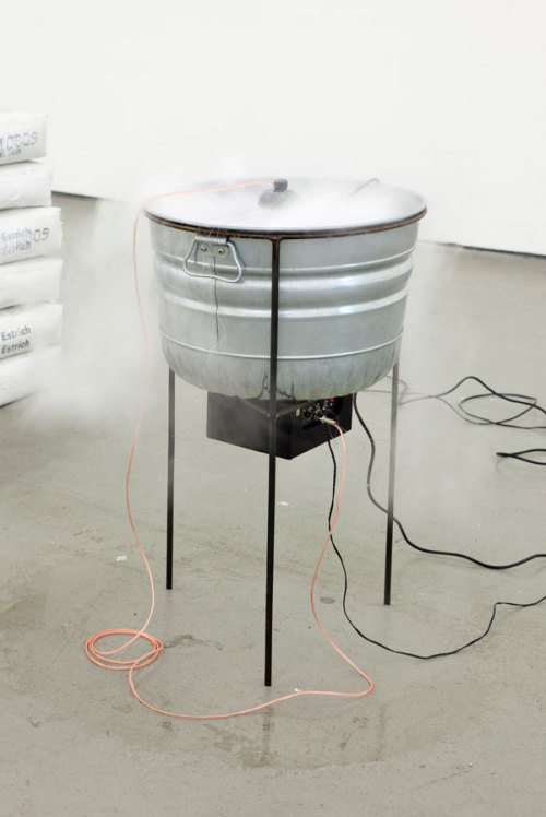 Nina Canell Perpetuum Mobile (2400 KG) 2009 28 Litres of  water, bucket, steel, hydrophone, mist-machine, amplifier, cable, 2400  kg concrete. Installation view  Kunstverein Hamburg, 2009