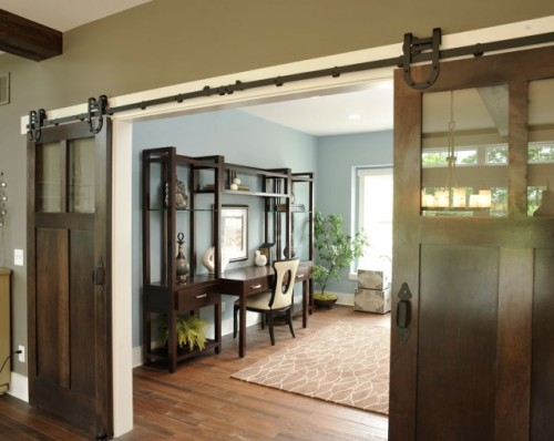 Rustic double sliding barn doors with horseshoe hardware lead into a home office (via Olentangy Falls ~ Delaware, OH - contemporary - home office - cincinnati - by Weaver Custom Homes)