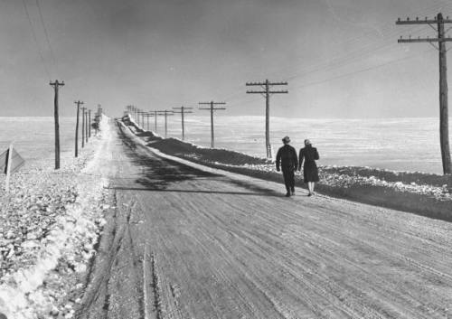 legrandcirque:  A couple walking along the snow covered road. Photograph by Bernard Hoffman. Maine, 1942.  WHAT.  this is the best photo in the history of photography.