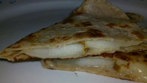 Tortilla stuffed with aged white cheddar and pears